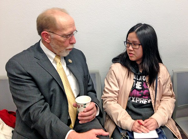 Iowa Congressman Dave Loebsack visits with SCC student Thu Nguyen.