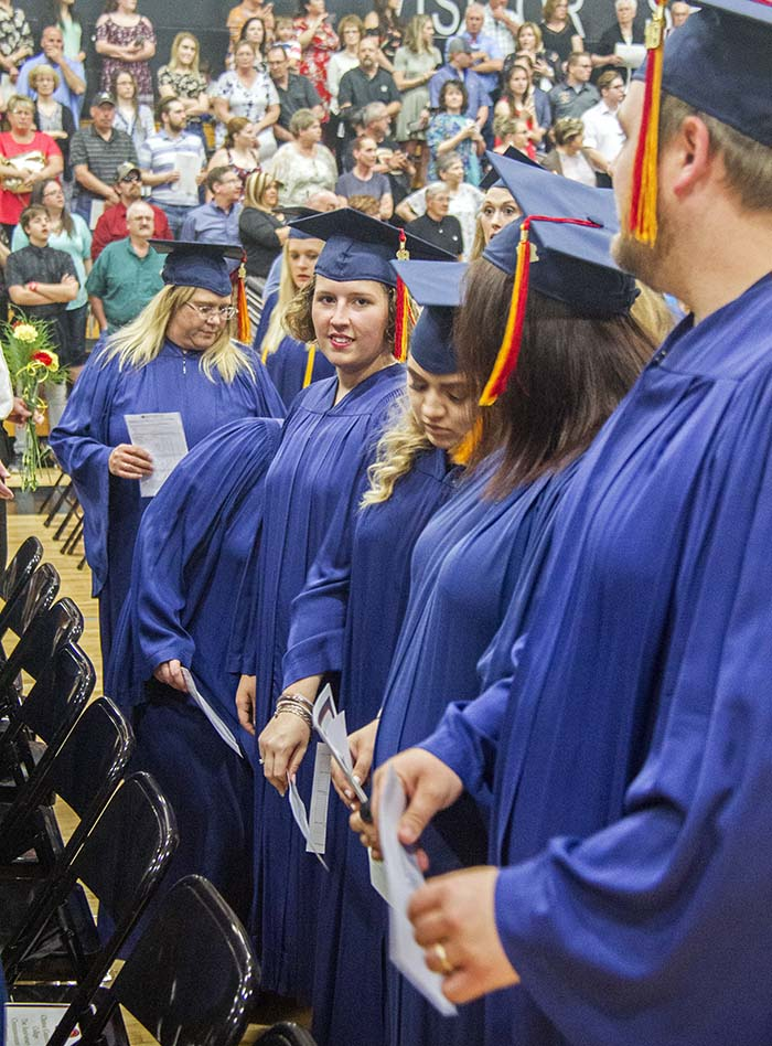 Students standing in rows during commencement ceremony