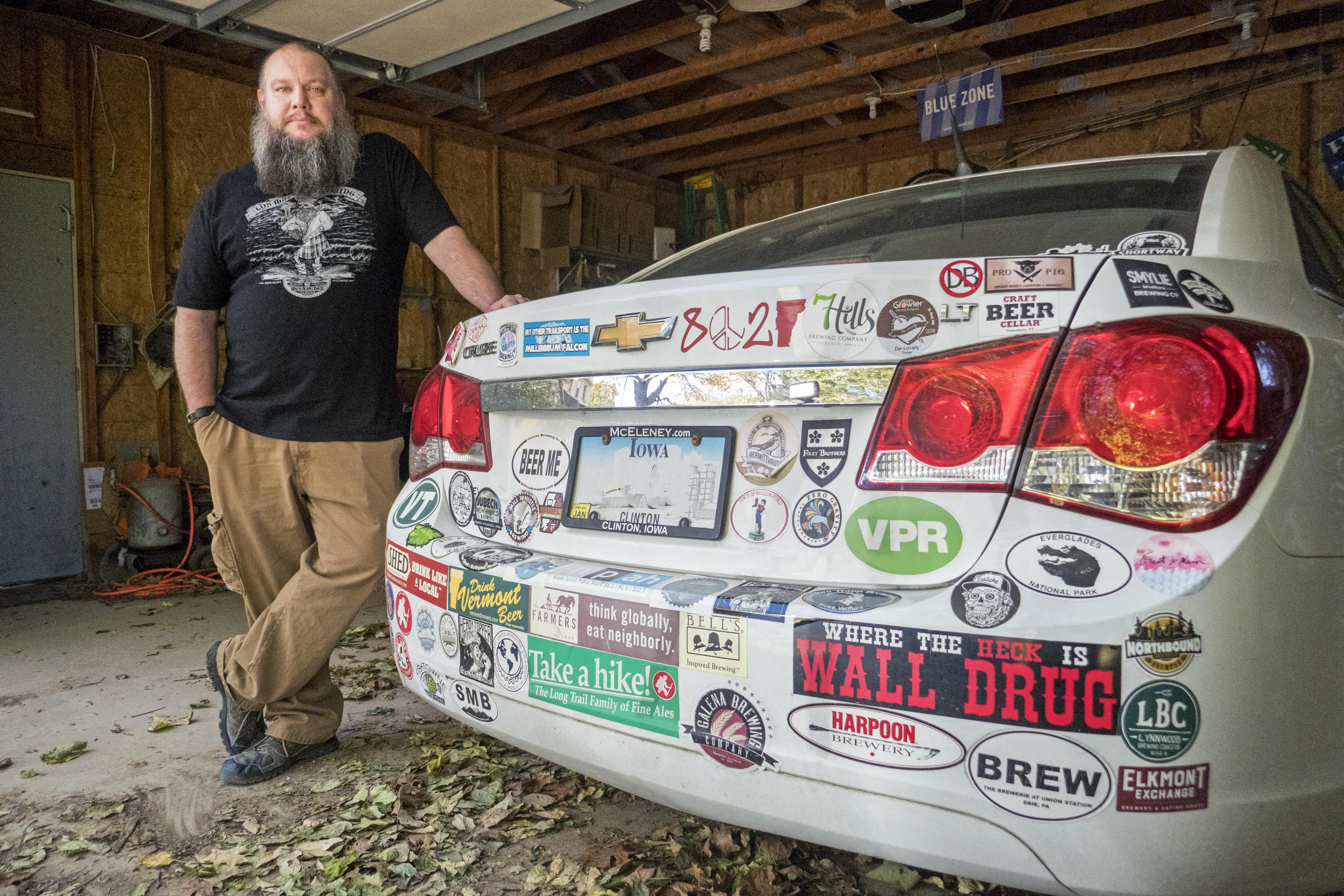 Ryan Welch standing with his car