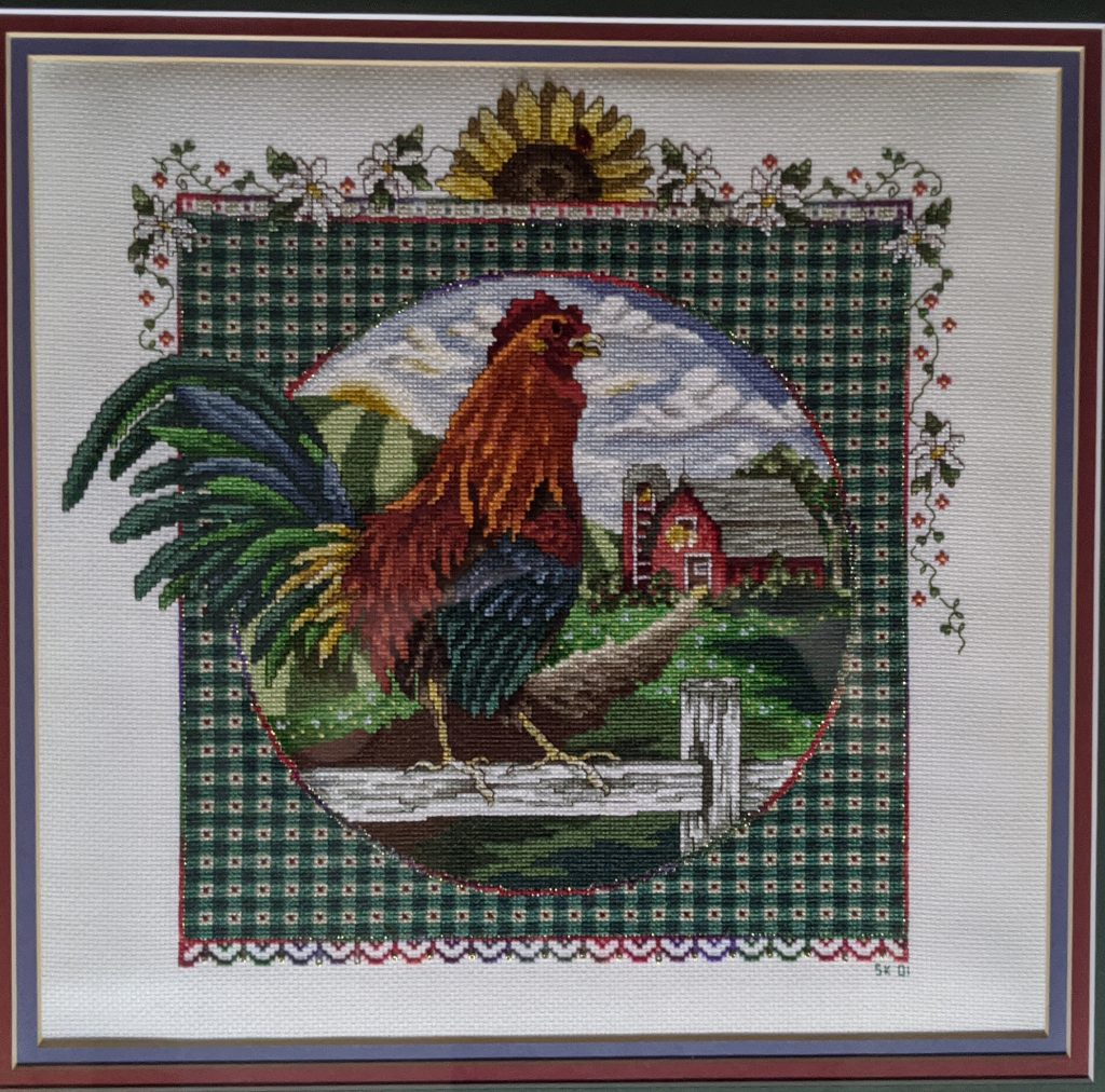 """Rejoice Rooster"" Cross Stitch, by Susan Kunde, Science Dept. Lab Assistant"