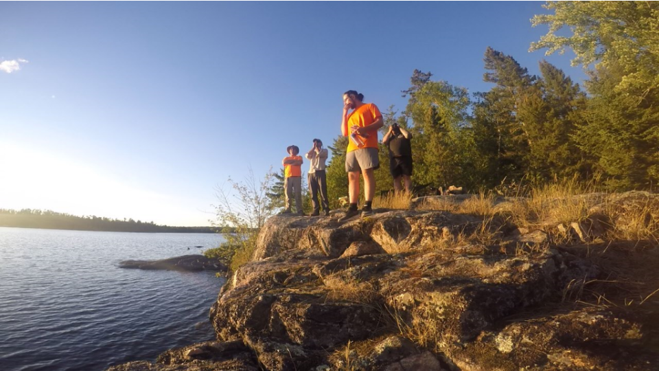 Students looking out over Lac La Croix in the BWCAW Photo: Allison Nodurft