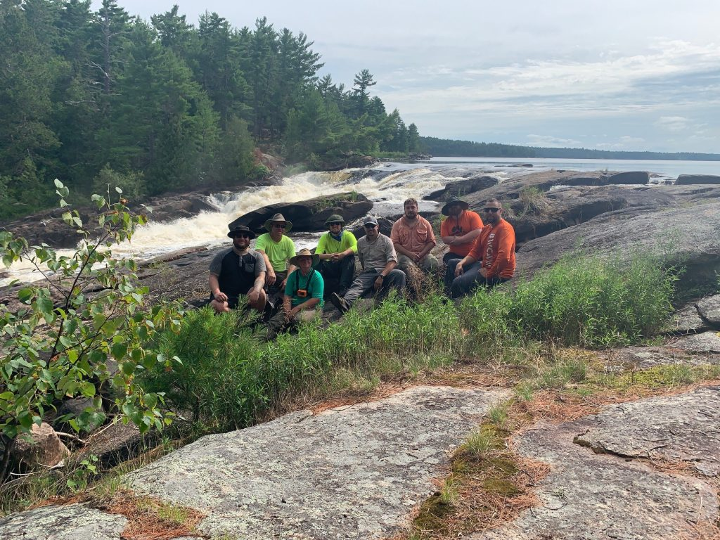 Wilderness Experience Students taking a break at Curtain Falls in the BWCAW. Photo by Colin Shirk