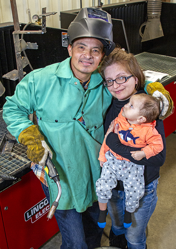 Photo of former welding student Miguel Salcedo and his family.